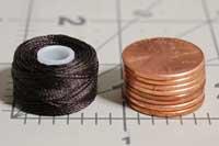 https://www.thethreadexchange.com/miva/graphics/00000001/style-a-class-15-bobbins-pennies.jpg