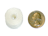 Style M bobbin compared to U.S. quarter